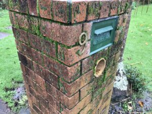 residential brick mailbox in need of cleaning