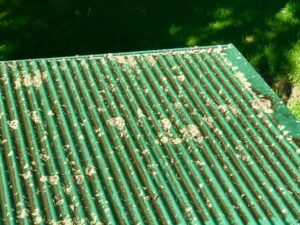 Dirty metal roof before NZTS roof treatment