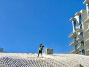 Waterblasting during NZTS commercial roof washing