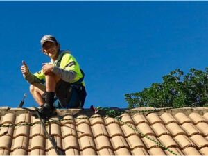 NZTS professional enjoying roof cleaning