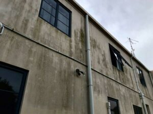 before exterior building wash