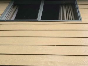 Clean house exterior after NZTS building wash service
