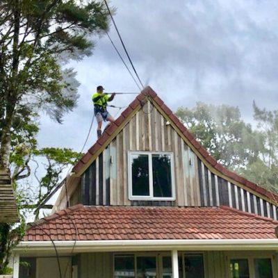 Waterblasting residential building roof